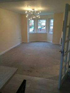 Bare floor in a living room before flooring is added