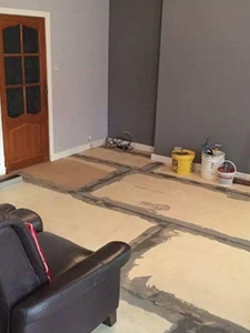 Smoothing compound being added between concrete floor slabs
