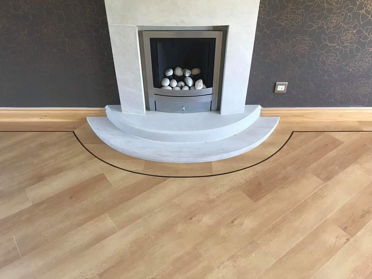 Border Detail in Karndean Opus wood plank around the fireplace