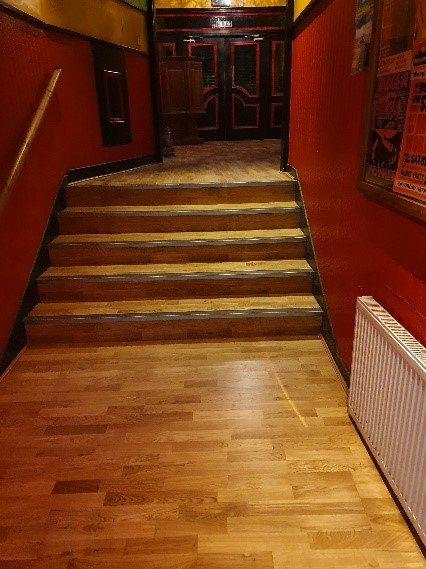 Restaurant safety flooring in hallway with stairs