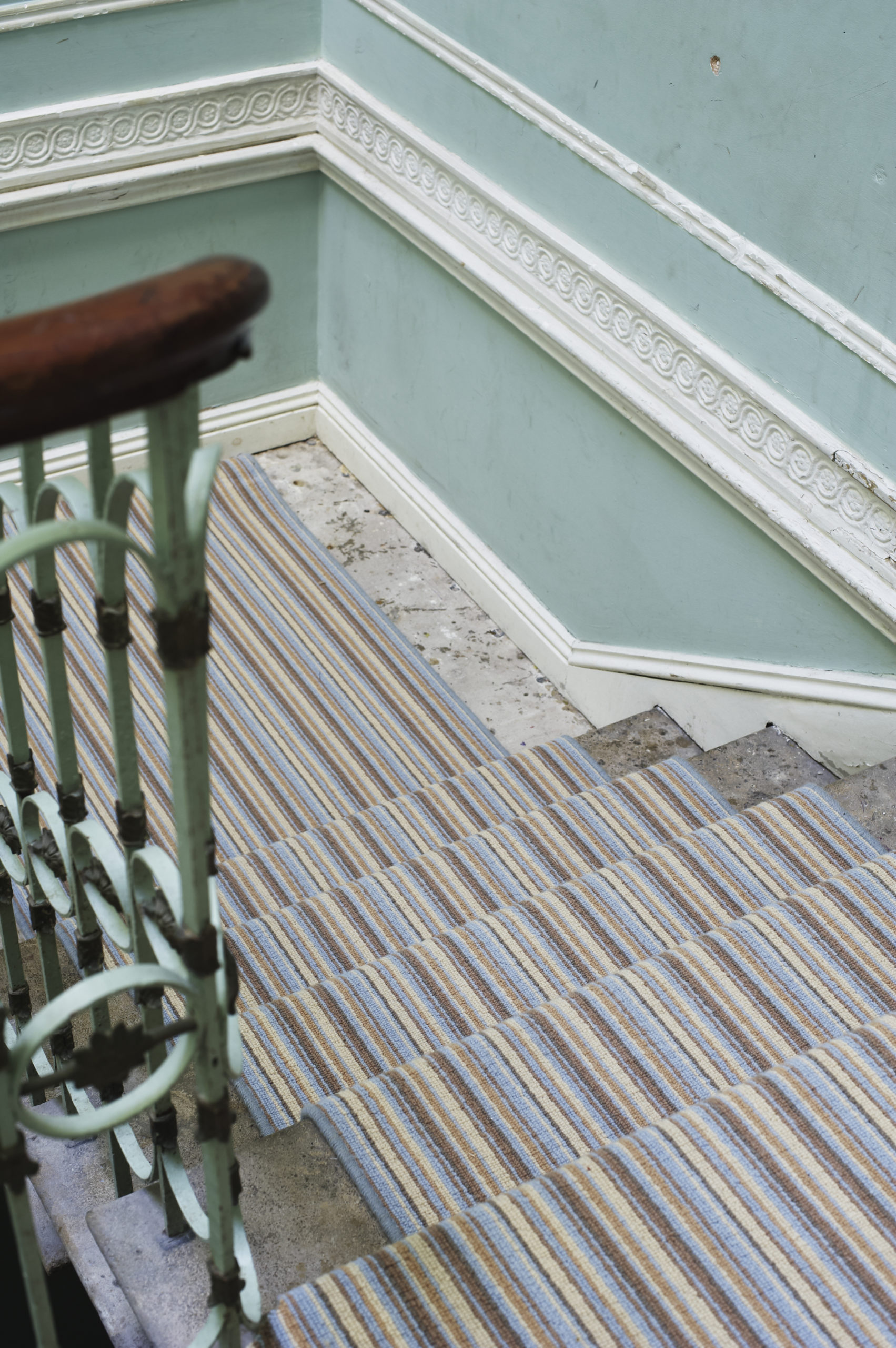Blue and Brown Striped Carpet on a stairwell.